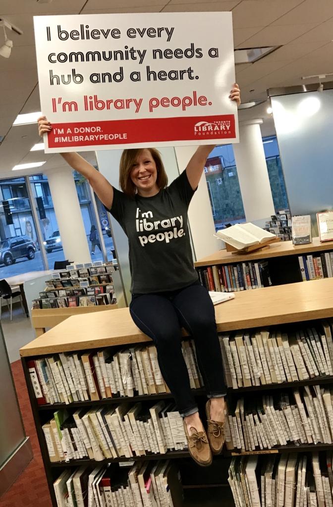 Rachel holding ILP Signage
